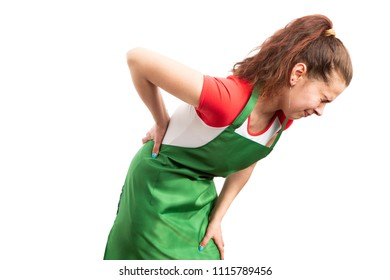 Young woman retail sales worker or storekeeper suffering backache and leaning as employee physical injury concept isolated on white background