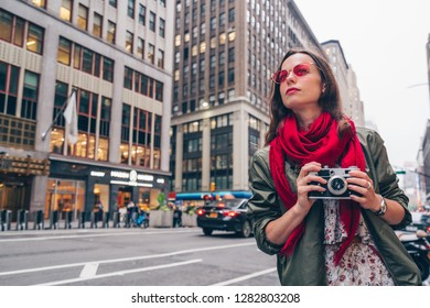 Young woman with a retro camera in New York City