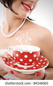 Young woman with retro tea cup