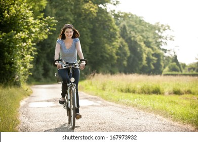 Young woman ride a bike
