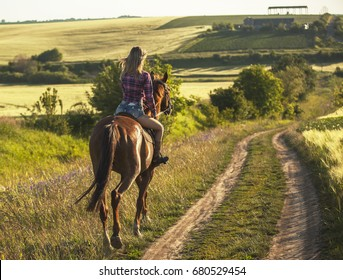 Young woman ride horse.