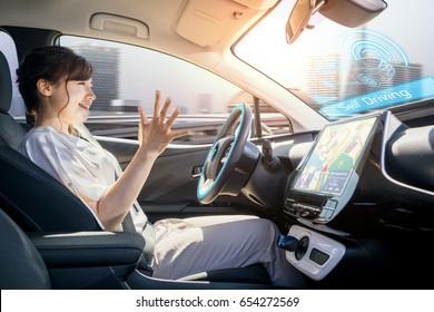 young woman riding autonomous car. self driving vehicle. autopilot. automotive technology.