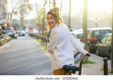 Young woman riding bicycle in Paris