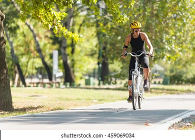 Young woman riding electric bicycle or e-bike