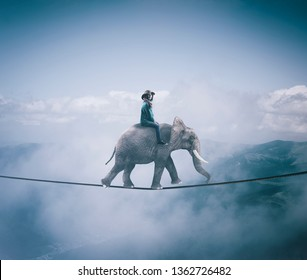Young woman riding an elephant on a rope at high altitude, above clouds and mountains.