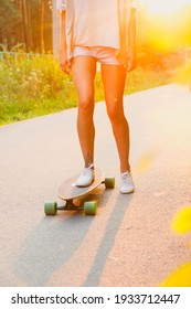 Young woman riding a skateboard in the city
