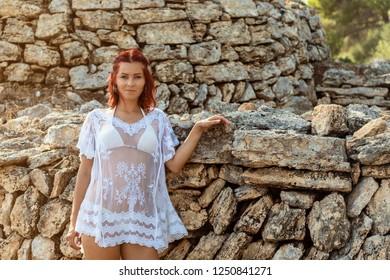 Young woman at rock wall