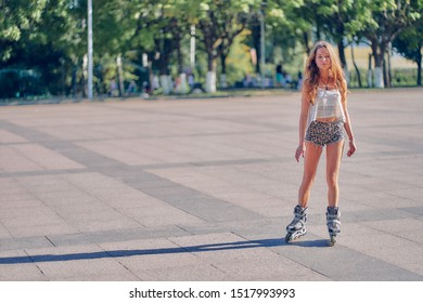 young woman rollerblading in the park