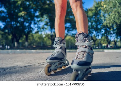 young woman rollerblading in the park. close-up