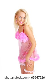 Young woman in a rose fluffy baby-doll