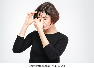 Young woman rubbing her eyes isolated on a white background