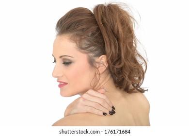 Young Woman Rubbing Shoulder