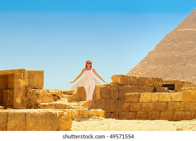 Young woman in the ruins of the Egyptian pyramids.