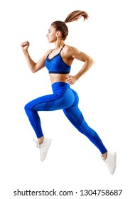 Young woman runner in blue sportswear jump in the air. Dynamic movement.