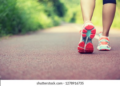 Young woman runner legs ready for running on trail