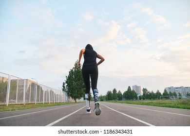 young woman runner running at the stadium outdoor.