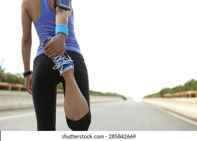 young woman runner warm up outdoor