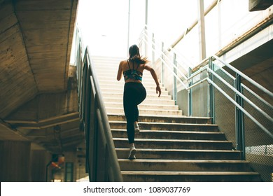 Young woman running alone up stairs  outdoor