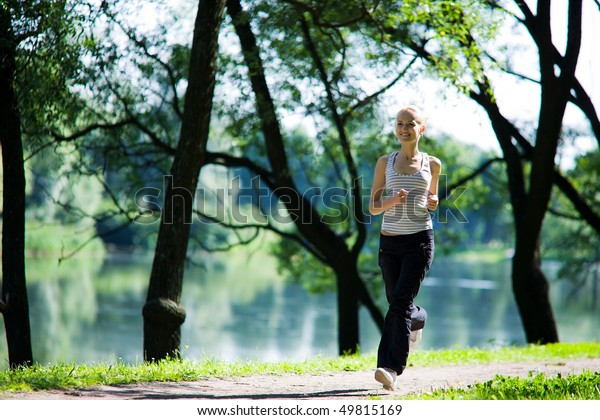 Young woman Running looking straight summer morning