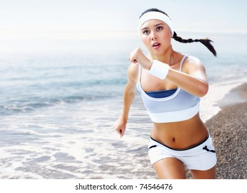 A young woman running near the sea