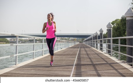 Young woman running with no skyline behind