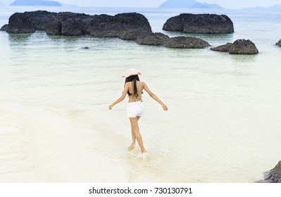 Young woman is running on beach, relaxing, thai woman.