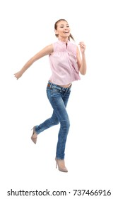Young woman running on white background