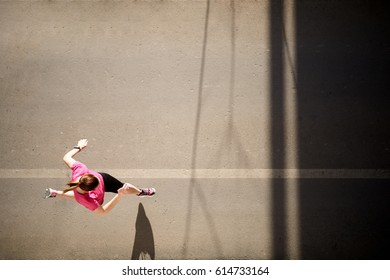 Young woman running outside