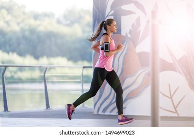 Young woman running in a urban city area