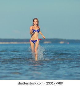 young woman running in the water