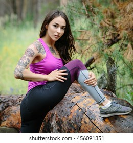 Young woman running in wood, training and exercising for trail run marathon endurance. Fitness healthy lifestyle concept.