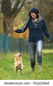 Young woman runs with her dog