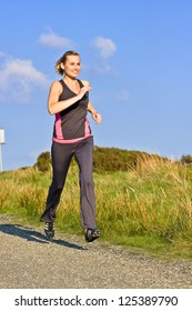 young woman runs outdoor in Wicklow Mountains