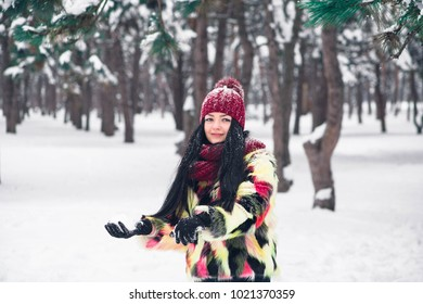 Young woman rushes with snow