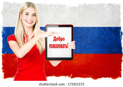 young woman with russian national flag on the background holding tablet pc. with sample text in russian language WELCOME!
