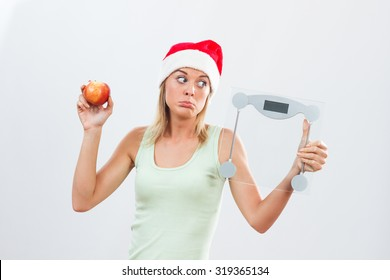 Young woman is sad because she has to exercise and eat healthy for holidays.No sweets for me for holidays