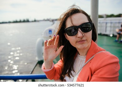 Young woman sailing on cruise liner or ferry with sea.