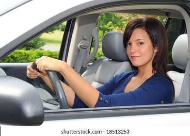 Young Woman Sat In The Drivers Seat of Her Car