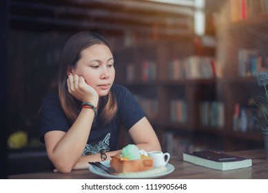 young woman sat sadly alone in the store.