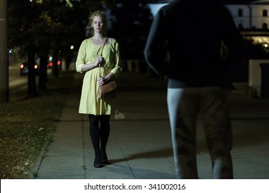 Young woman is scared of everything on the street
