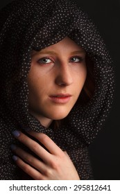 Young woman with scarf over her head