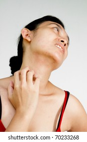 Young woman scratching neck and face with allergy skin problem