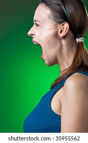 A young woman screaming dramatically in profile.