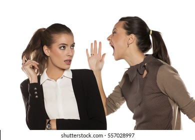 young woman screaming at her friend's ear