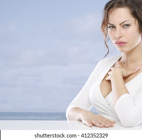 Young woman at the seaside