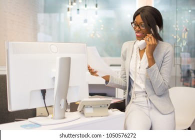 Young woman secretary working in modern office.