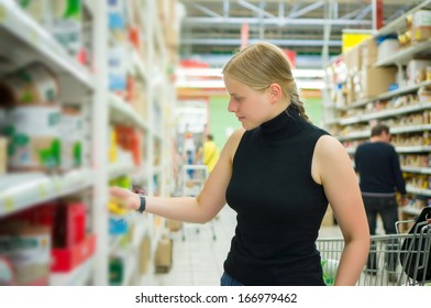 Young woman select bakery products in supermarket