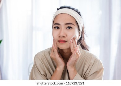Young woman self face  massage at home