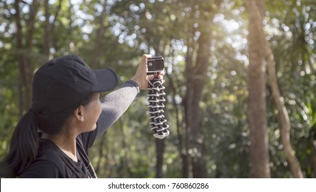 Young woman selfie action cam enjoy with nature national park .