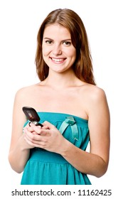 A young woman sending a text message with a mobile phone